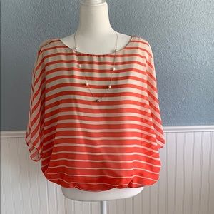 Coral and cream colored striped blouse